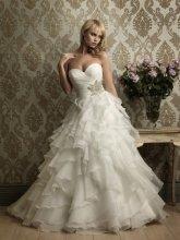 Dámské svatební šaty s volány